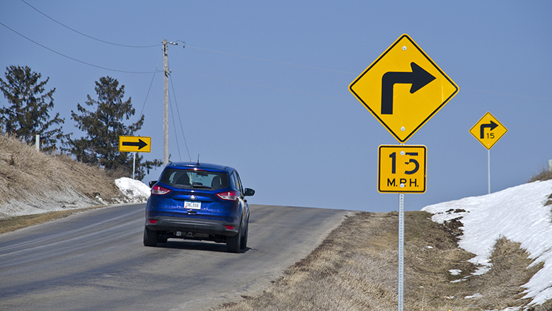 car driving right curve sign