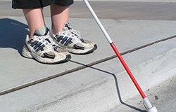 Visually impaired pedestrian using cane