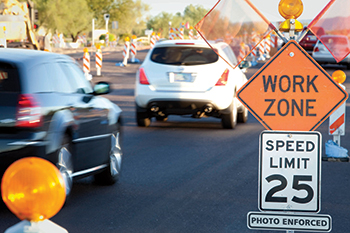 Speed enforcement signs in workzone area