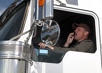 Image of yawning truck driver