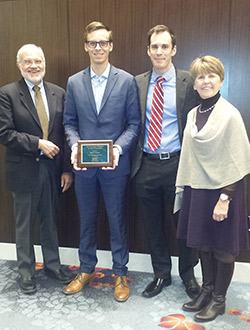 Image of award recipient with Donath, Work, and McGinnis